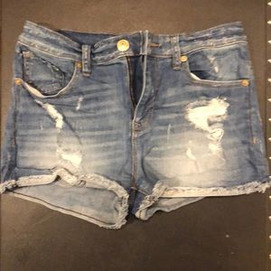 Express roll up gemmed jean shorts
